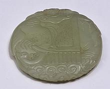 A CHINESE WHITE JADE CIRCLE SHAPED PENDANT carved as an elephant, 18th/19th Century, 5.2cm diameter