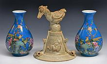 A QINGBAI GLAZED POTTERY PHOENIX with three applied cloud medallions, Song dynasty and a pair of sma