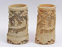 TWO CANTON IVORY SPILL HOLDERS, figures and pine trees, 19th Century, 10cm high