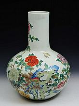 A CHINESE PORCELAIN BOTTLE VASE, flowering peonies, rockwork and insects, Qianlong mark, 19th Centur