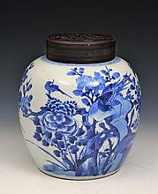 A CHINESE BLUE AND WHITE PORCELAIN OVOID JAR, peonies, birds and rockwork, with hardwood cover, Kang