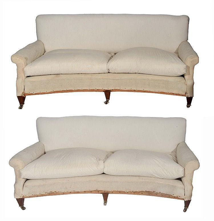 A PAIR OF HOWARD & SONS CONCAVE FRONT SOFAS with