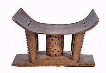 AN ASHANTI CARVED WOODEN 'QUEEN MOTHER' STOOL with pierced and carved supports,