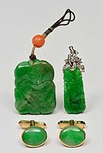 TWO GREEN CARVED JADE PENDANTS and a pair of jade