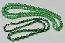 TWO CHINESE GREEN JADE NECKLACES