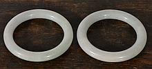 A PAIR OF CHINESE WHITE JADE CIRCULAR PLAIN