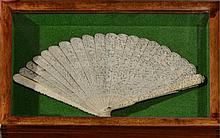 A CHINESE CANTON CARVED IVORY BRISE FAN with
