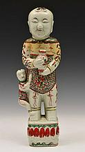A CHINESE PORCELAIN WUCAI STANDING FIGURE of a boy