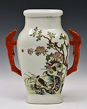 A CHINESE PORCELAIN TWO HANDLED VASE of flattened