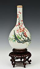 A CHINESE PORCELAIN BOTTLE VASE decorated in