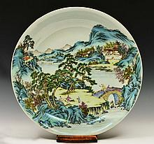 A CHINESE PORCELAIN CHARGER decorated in the