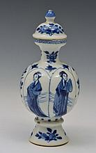 A CHINESE SMALL PORCELAIN VASE with panels of