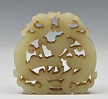 A CHINESE MUTTON FAT JADE PENDANT carved and