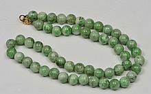 A CHINESE PALE GREEN JADE NECKLACE