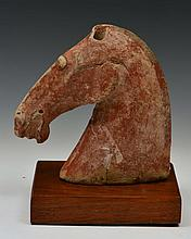 A CHINESE POTTERY HEAD OF A HORSE, mounted, Han