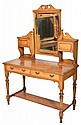 A VICTORIAN OAK AND ASH DRESSING TABLE with carved