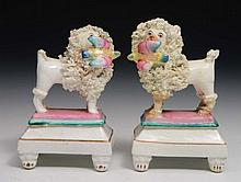 A pair of small English porcelain models of poodles  19th Century,