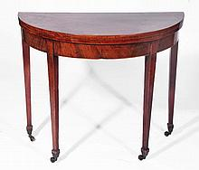 A 19th Century mahogany tea table  half round on tapering supports