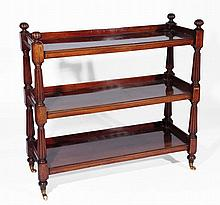 A Victorian mahogany bookcase  of three tiered form with reeded su