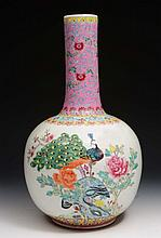 A Chinese porcelain bottle vase  20th Century painted with peacock