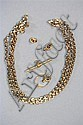 A GOLD CHAIN LINK NECKLACE; a 9ct gold T bar and