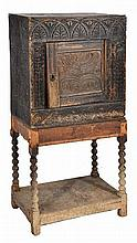 A 17TH CENTURY STYLE OAK CUPBOARD with chip carve