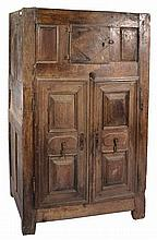 A 17TH CENTURY AND LATER OAK CUPBOARD of pegged p