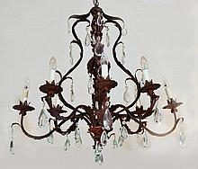 A FRENCH STYLE SEVEN-LIGHT BRONZED CHANDELIER wit