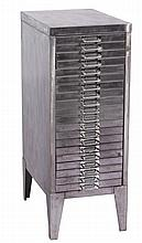 A POLISHED STEEL CHEST with twenty shallow drawer