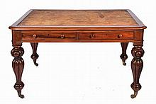 A WILLIAM IV/EARLY VICTORIAN WALNUT LIBRARY TABLE