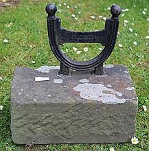 A VICTORIAN CAST IRON BOOT SCRAPER, set into a st