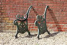 A PAIR OF VICTORIAN CAST IRON GREEN PAINTED BENCH