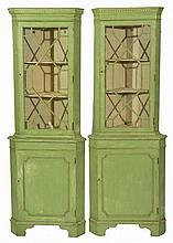 A PAIR OF GEORGIAN STYLE GREEN PAINTED FLOOR STAN