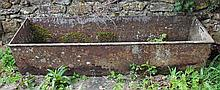 AN OLD RECTANGULAR CAST IRON WATERING TROUGH, wit