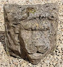 A WEATHERED CAST COMPOSITE STONE LION MASK WALL M