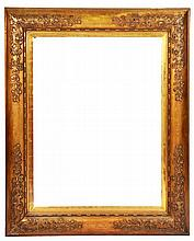 A LARGE GILT CUSHION MOULDED PICTURE FRAME with f
