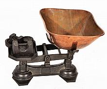 A SET OF ANTIQUE CAST IRON KITCHEN SCALES with a
