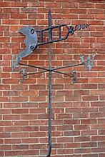 AN OLD BLACK PAINTED WROUGHT IRON WEATHER VANE, t
