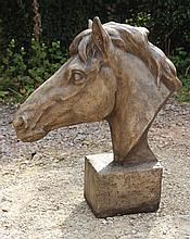 A CAST RECONSTITUTED STONE SCULPTURE OF A HORSES