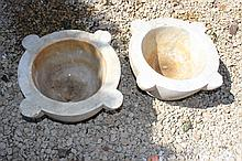 A PAIR OF ANTIQUE MARBLE MORTARS each with four l