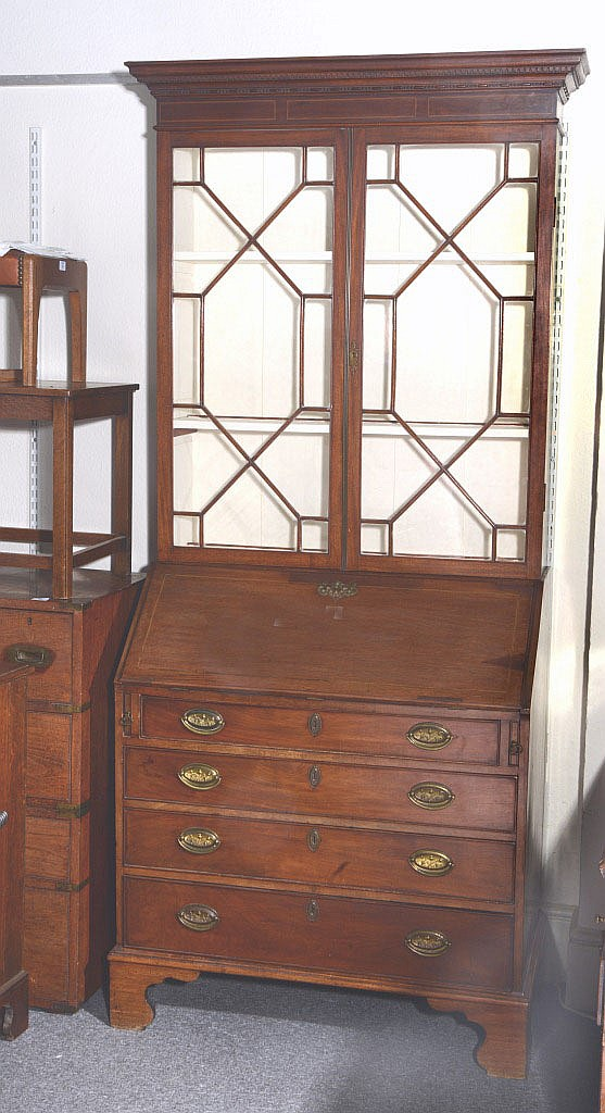 A GEORGIAN MAHOGANY BUREAU BOOKCASE, the upper