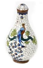 AN ENAMEL SNUFF BOTTLE WITH PEACOCK CARVING