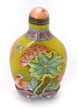 A YELLOW SNUFF BOTTLE WITH FLORAL CARVING