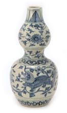 A BLUE AND WHITE GOURD SHAPED PORCELAIN VASE - MING DYNASTY