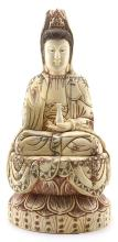 A BONE CARVED FIGURE OF SITTED 'GUAN YIN'