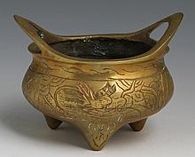 CHINESE TWO HANDLE BRASS FOOTED CENSER