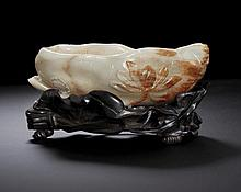 AN IMPERIAL WHITE AND RUSSET JADE LOTUS BRUSH WASHER