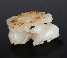 A WHITE AND RUSSET JADE PENDANT OF RAM GROUP