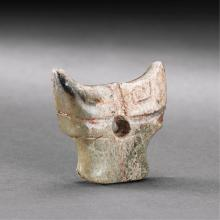 A CHINESE UNEARTHED  JADE 'OX HEAD' PENDANT