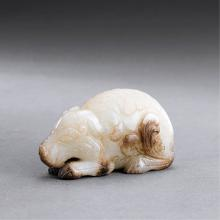 A CHINESE WHITE JADE BEAST CARVING